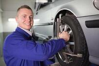 Photo of mechanic doing wheel alignment at car body repairs Gloucester.